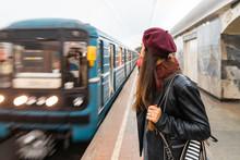 Woman Waiting At Metro Station...