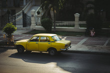 An Old Yellow Car Parked