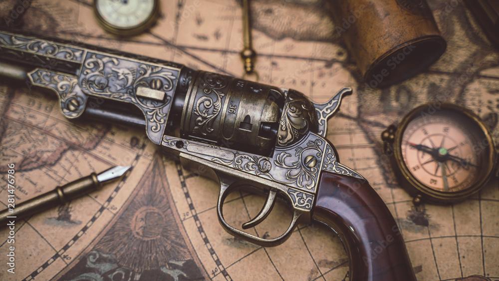 Fototapeta Vintage Pistol Gun And Compass