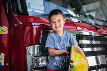 Little Boy On Red Fire Engine