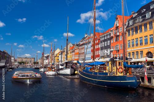 Garden Poster Scandinavia Sightseeing boat sailing by the harbour Nyhavn of Copenhagen
