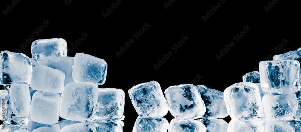 Fototapety, obrazy: Pieces of frosty ice cubes on black reflective surface background.