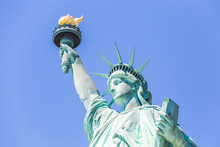 Close View Of The Statue Of Liberty Over Blue Sky