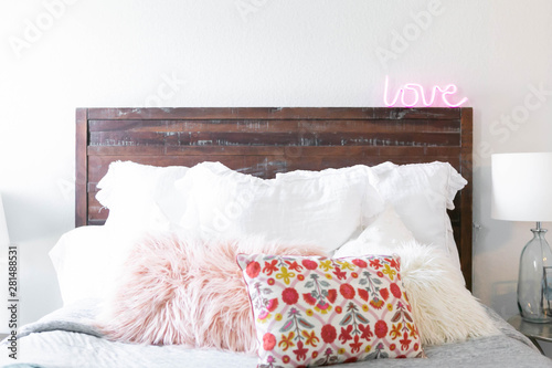 Modern Bed With Decorative Pillows And Neon Sign Cute Girl