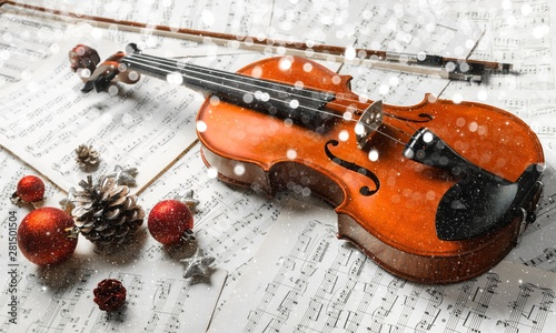 Tableau sur Toile Close-up Photo Of Violin, Musical Notes and Christmas decoration