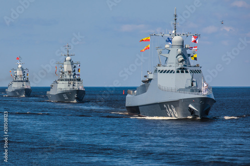 Leinwand Poster A line ahead of modern russian military naval battleships warships in the row, n