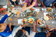 High angle view of multigenerational family having food at table