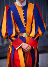 Midsection Of Pontifical Swiss Guard Standing Outdoors