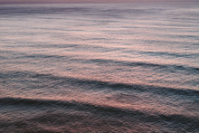 Aerial View Of Rolling Waves In Sea At Dusk