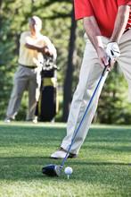 Senior Golfers Teeing Off On Golf Course