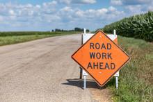 Road Work Ahead Sign On Barric...