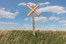 Railroad Caution Sign On Prairie Landscape