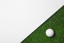 Golf Ball And White Paper On G...