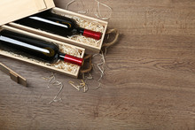 Wooden Crates With Expensive Wine On Table, Flat Lay. Space For Text