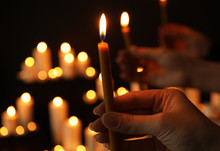 Woman Holding Burning Candle I...