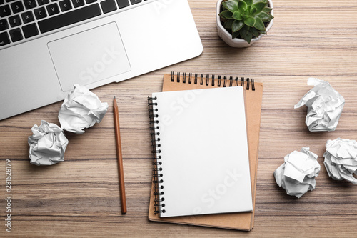 Flat lay composition with notebook and crumpled paper on wooden table Tablou Canvas