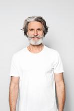 Portrait Of Charming Mature Man On Light Grey Background
