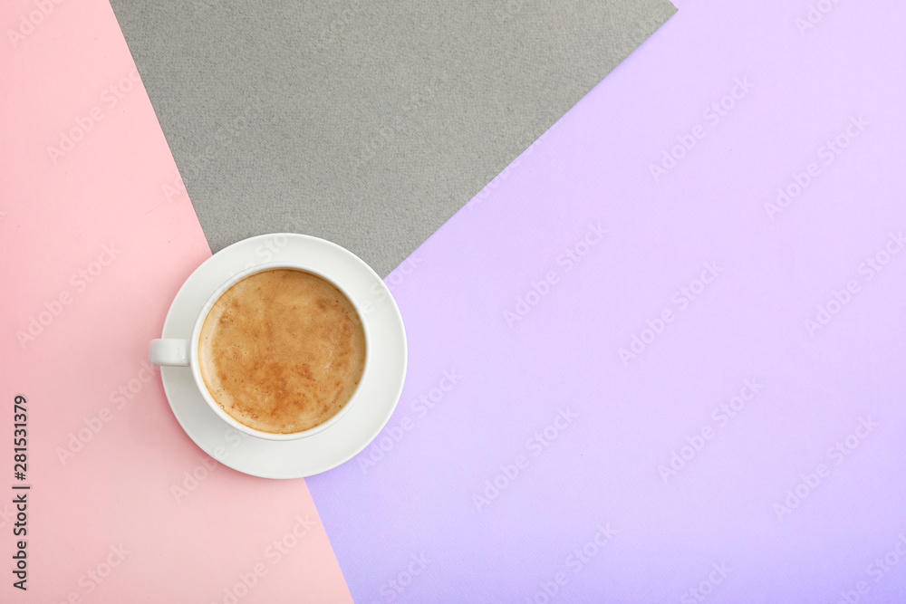 Fototapeta Cup of coffee on color background, top view. Space for text