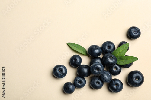Recess Fitting Countryside Fresh acai berries with leaves on beige background, flat lay. Space for text