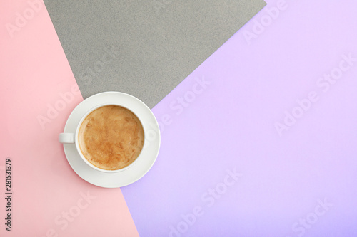 Cuadros en Lienzo  Cup of coffee on color background, top view. Space for text