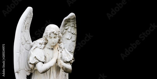 Guardian angel sculpture with open wings isolated on wide panorama banner black background with empty text space Fototapeta