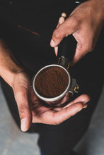 Close Up Of Barista Holding Portafilter With Grounded Coffee Powder