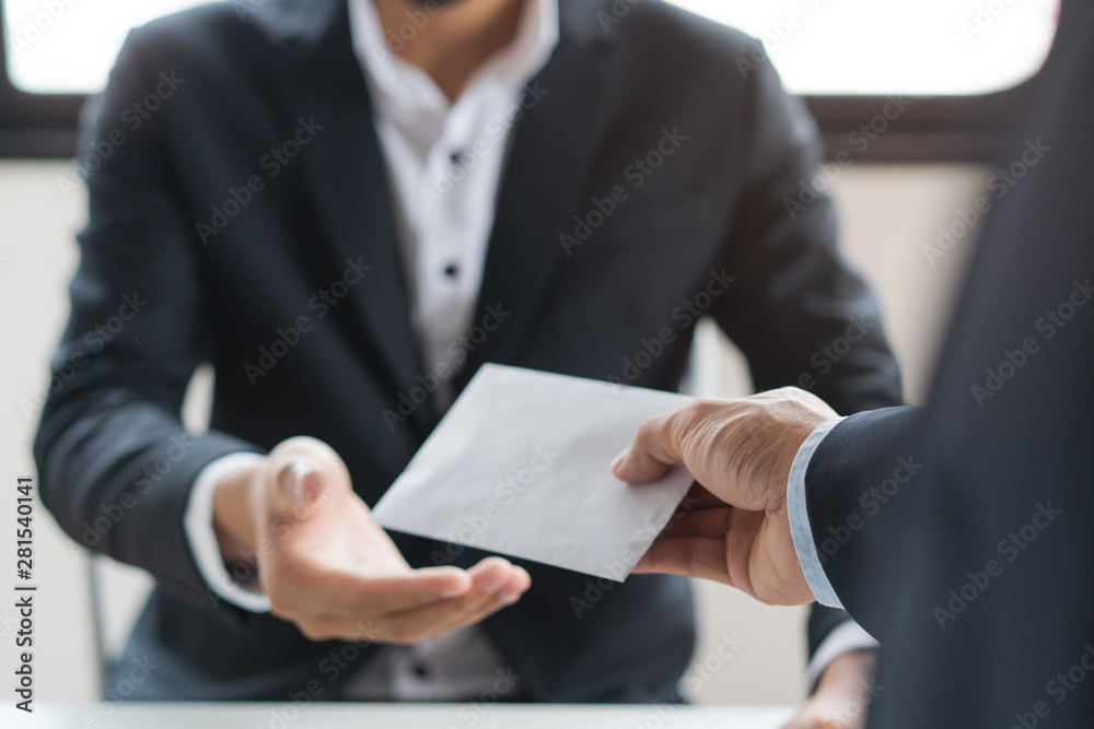 Fototapeta Close up view of  office worker receiving salary from boss.
