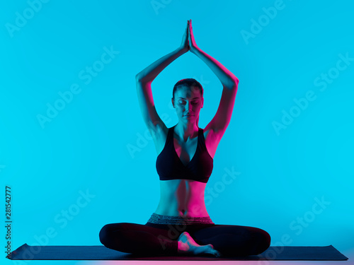 Poster Ecole de Yoga one caucasian woman exercising Padmasana Lotus position yoga exercices in silhouette studio isolated on blue background