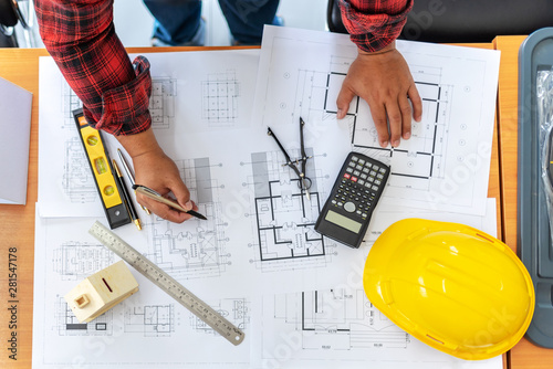 Fototapeta  High Angle View Of Engineer Asian Person Drawing Architect Plan On Table Overweight