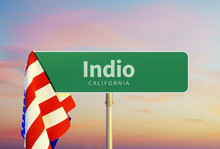 Indio – California. Road Or Town Sign. Flag Of The United States. Sunset Oder Sunrise Sky. 3d Rendering