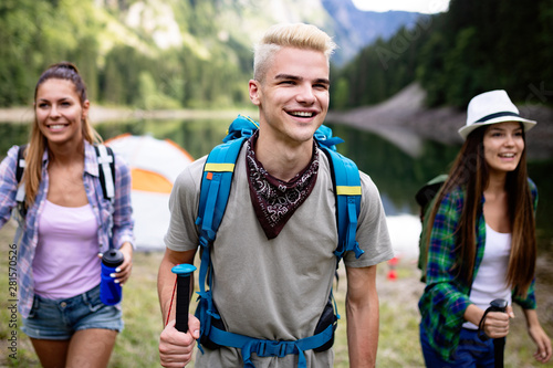 Fototapeta Group of happy young people friends hiking together outdoor obraz na płótnie