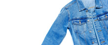 Close-up Blue Denim Jacket On Isolated White Background Top View Flat Lay Copy Space. Denim, Fashionable Jacket, Women's Or Men's Trend Clothing, Fashion Background. Store Concept, Sale
