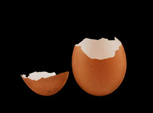 Brown Egg Shells Isolated On Black Background