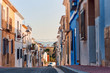 Old town of Denia with narrow streets and coloured houses.