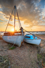 Stunning Sunset Over Old Fishing Boats On The Shore At West Mersea,