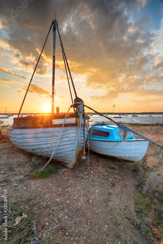 Stunning sunset over old fishing boats on the shore at West Mersea, Canvas Print