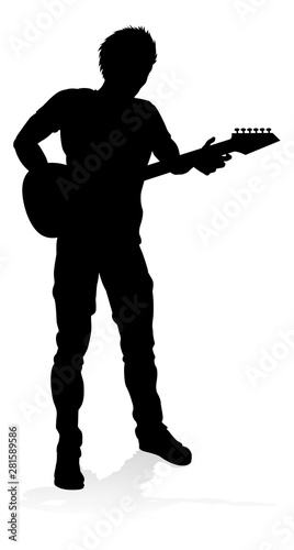 Obraz na plátně A guitarist musician in detailed silhouette playing his guitar musical instrument