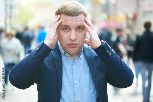 puzzled man is standing on the street