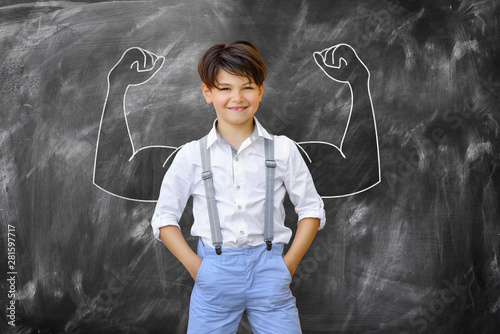 Obraz Schoolchild shows muscle - fototapety do salonu