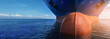 canvas print picture - Close up of large blue merchant crago ship in the middle of the ocean underway. Performing cargo export and import operations.