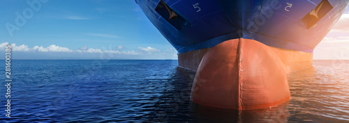 Fototapeta Close up of large blue merchant crago ship in the middle of the ocean underway