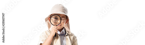 Fotografie, Obraz panoramic shot of curious explorer boy in hat looking through magnifier isolated