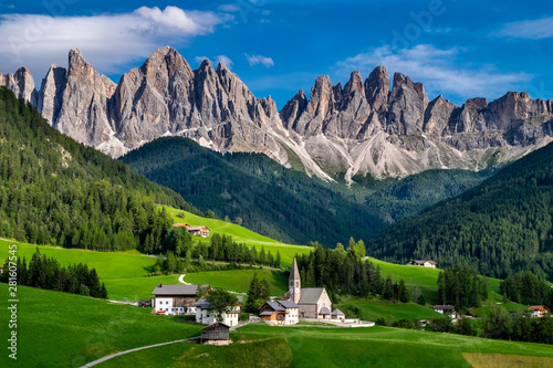 Aluminium Prints Alps The St Magdalena Church with the Odle mountain range towering above it, Funes Valley, Dolomites, Italy.