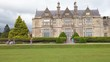 Muckross House mansion, Killarney National Park. Extreme push in through visitors to building exterior close up.