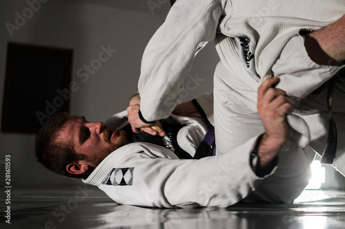 Brazilian jiu jitsu BJJ sparing in training two athletes martial arts fighters w Tablou Canvas