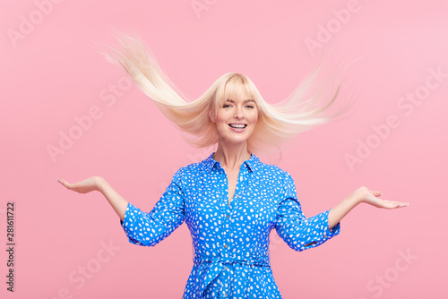 happy crazy excited  woman with wild long blond hair in the wind screaming Tablou Canvas