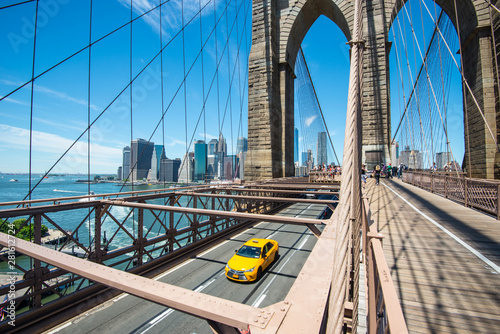 Photo  New York Manhattan skyline from the Brooklyn Bridge with yellow taxi