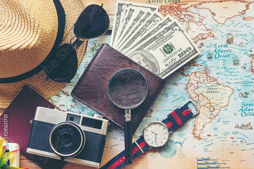 Fototapeta Top view of Traveler accessories and items man with black for planning travel vacations on the world, copy space