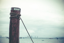 Rope Tied To Wood, Natural Background, Sea, Wooden Pier