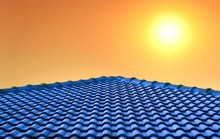 The Old Blue Tiles Roof Slope In Pyramid Shaped Against Colorful Sunrise Sky Background At Morning Time, Building And Architecture Design Concept
